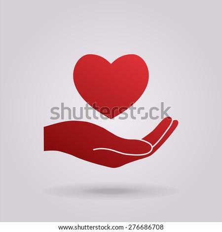 Hand holding heart.