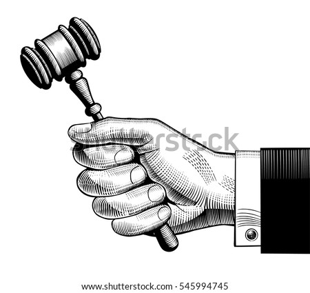 hand holding judges gavel....