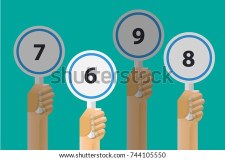 hand holding judges score. Foto stock ©