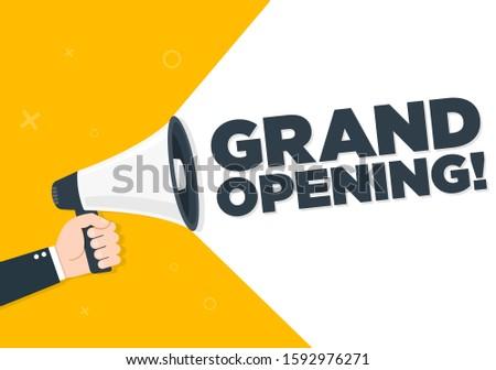 Hand holding megaphone - Grand Reopening, vector illustration