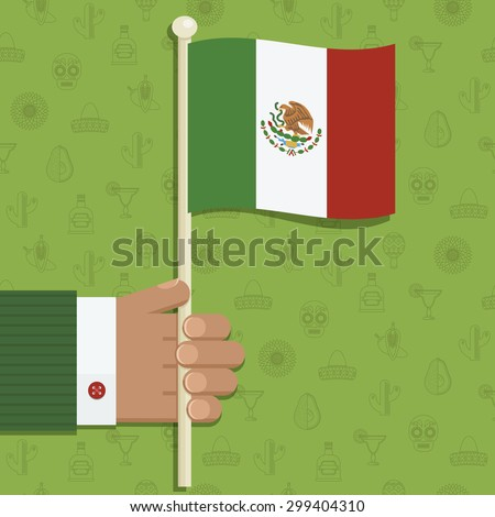 hand holding mexican flag on