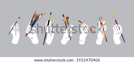 Hand holding paintbrushes. Hand drawn vector illustration of hands with art tools.  Doodle style. Workshop, art studio, workplace, artist, art shop, painting. Hand, palm, wrist, fingers, nails.