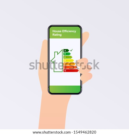Hand holding phone with energy efficiency rating. Smart home. Flat design style vector illustration concept of smart house technology system with centralized control.