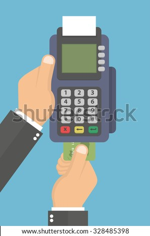 hand holding pos terminal and