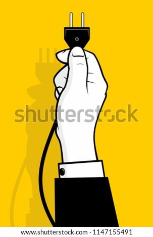 Hand holding power plug