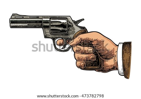 hand holding revolver for fired