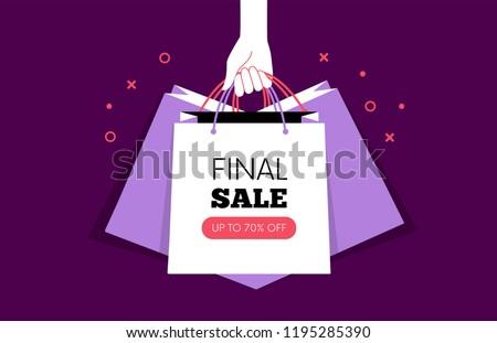 Hand holding Shopping bags. Black Friday. Vector illustration