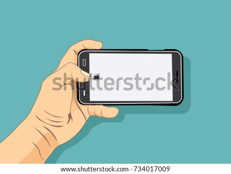 hand holding smart phone to