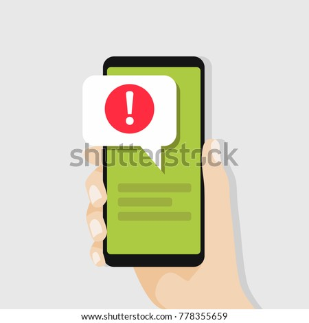 Hand holding smartphone with speech bubble and exclamation point icon. vector