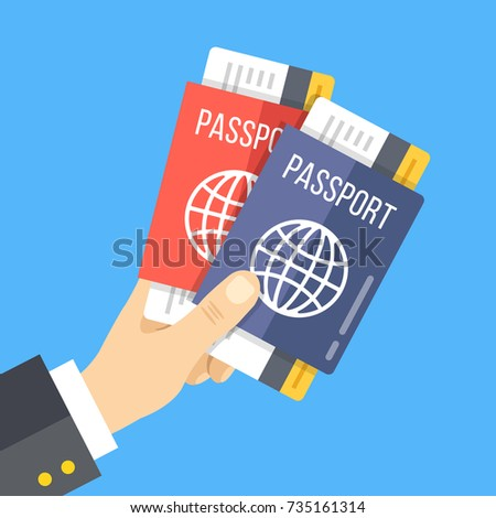 hand holding two passports with