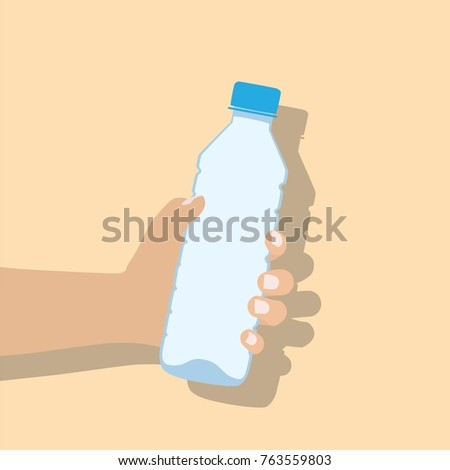 hand holding water bottle