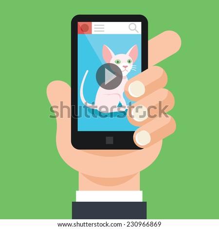 hand holds black smartphone