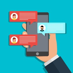 Hand holds phone chat. Message icon on screen mobile. Online talk in social media. Texting notifications in smartphone. Popup dialog sign. Person's chatbot in flat style. Man send text in app. vector