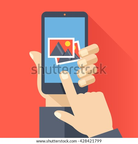 hand holds smartphone with