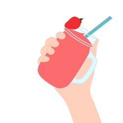 Hand is holding a red smoothie in a glass cup with and has strawberry on top. A cold soft drink for summer. Sweet beverage. Tasty and yummy food. A takeaway Product logo or advertisement.