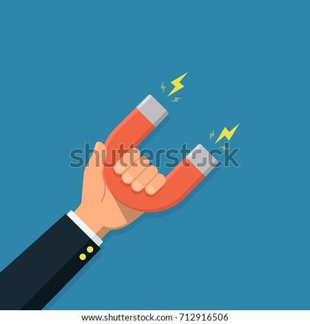 Hand of a businessman with magnet. Business concept of the attraction of money, customers and investment. Vector illustration in a flat style.