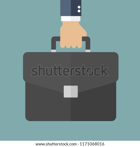 Hand of businessman holding briefcase
