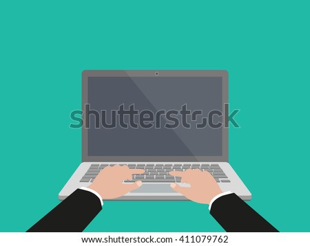 Hand on laptop keyboard with blank screen monitor