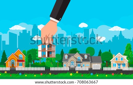 Hand picks a house. Suburban village, flowers, trees, road, sky and clouds. Real estate, sale and rent house, mansion. Vector illustration in flat style