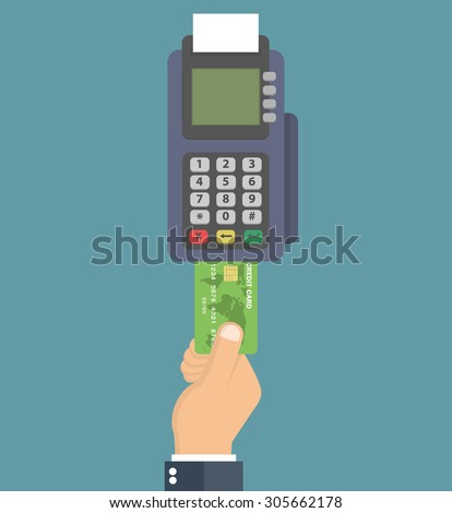 hand pushing credit card into