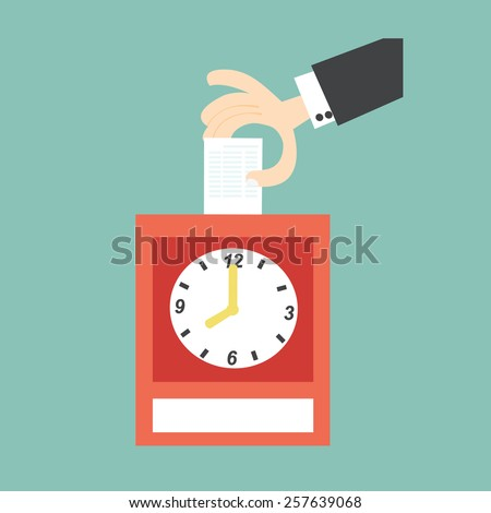 Hand putting card in time clock