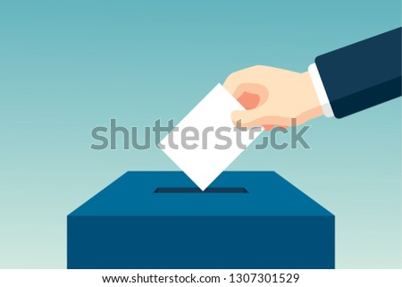 Hand Putting Voting Paper