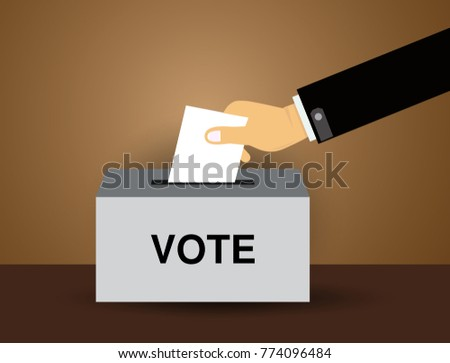 hand putting voting paper in the ballot box ,  voting ballot in a slot of box