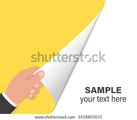 Hand turns page on white background. Hand turning empty page. Close up of hand turning the blank page with copy space