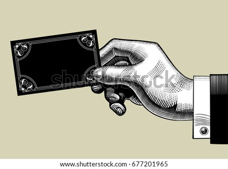 Hand with a visiting card. Vintage engraving stylized drawing. Vector illustration