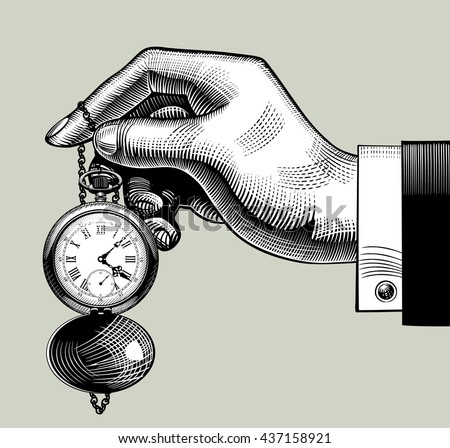 hand with an old clock. retro...