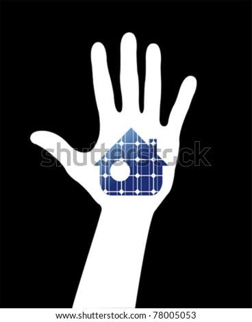 Hand with solar house. Save energy