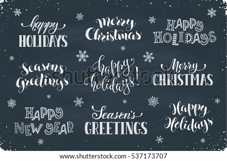 Hand written New Year phrases. Greeting card text template with snowflakes drawn on chalkboard. Happy holidays lettering in modern calligraphy style. Merry Christmas and Season's Greetings lettering.
