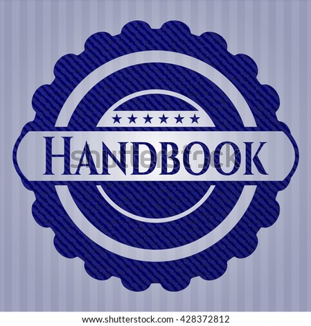 Handbook emblem with jean background