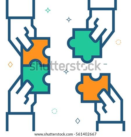 hands assembling puzzle ...