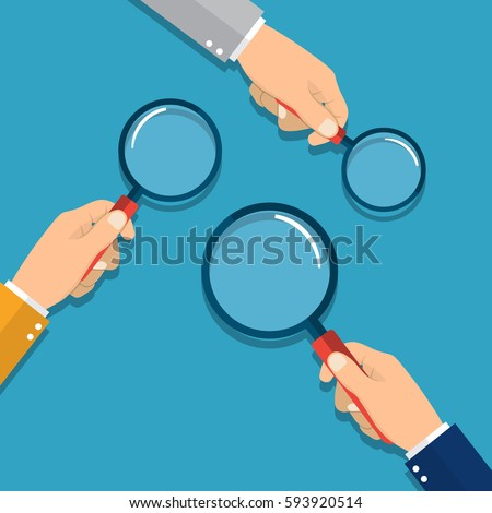 hands holding a magnifying