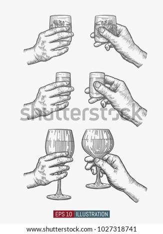 hands holding glasses set