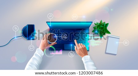 Hands of developer working on keyboard of laptop on white desk. top view. Workplace of programmer with notebook, table plant, smartphone, icons and interface elements.