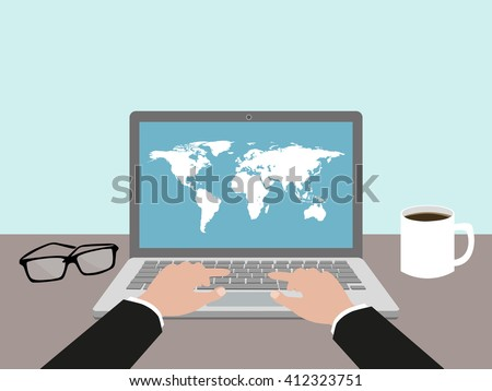Hands on laptop keyboard pushing keys, coffee,world map and glasses on the desk. World map on the screen. Office desk concept. Flat style