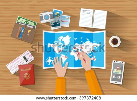 hands paper map of world and