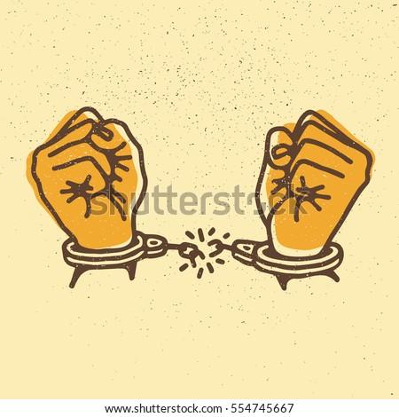 hands with broken shackles