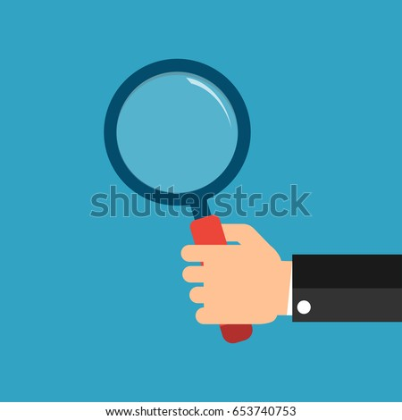Hands with magnifying glass.