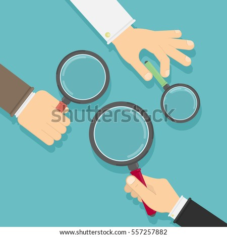 Hands with magnifying glass. Concept of searching, detecting and analyzing.