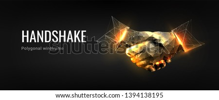 Handshake.Polygonal wireframe composition. Technology and innovation in bussines. Abstract illustration isolated on dark background. Particles are connected in a geometric silhouette.