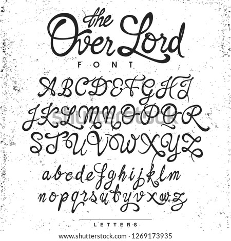 Handwritten calligraphy ¨The Over Lord¨ font, black on the gris textured background