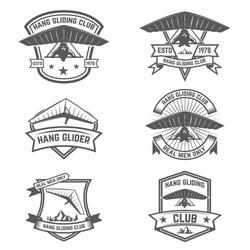 Hang gliding club emblems. Design elements for logo, label, badge, sign. Vector illustration