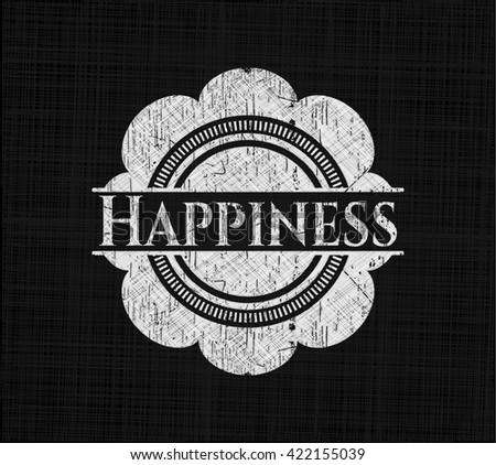 Happiness written on a chalkboard