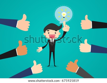 Happy and proud businessman get ideas for business with many thumbs up hands around him.