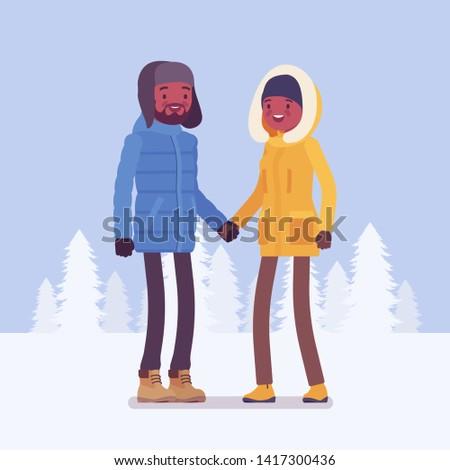 happy black couple in winter