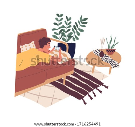 Happy boy lying on sofa and surfing internet. Young man chatting in social network or messenger. Teenager spending time at home, playing game on smartphone. Vector illustration in flat cartoon style