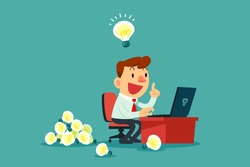 Happy businessman working at his desk and creating a lot of idea bulbs. Business idea concept.